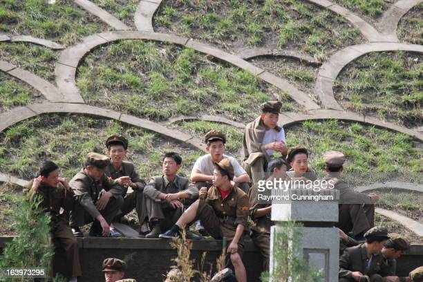 CONTENT] To meet the goal of 100000 apartments in Pyongyang university students were marched off to work in 2011 This is one of the work brigades...