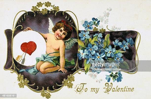 To My Valentine' American Valentine card 1907 Cupid holds a heart pierced by an arrow The flowers are Forgetmenots In Roman mythology Cupid was the...