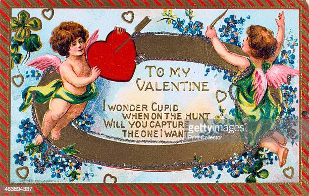 'To My Valentine' American Valentine card c1908 Cupid shoots an arrow into a heart held up by a putto The words are surrounded by garlands of...