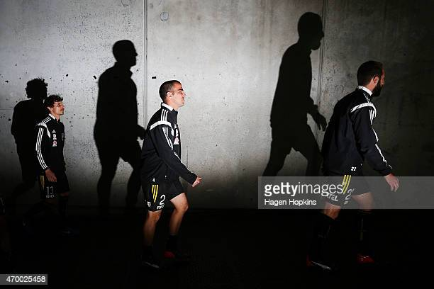 L to R Albert Riera Manny Muscat and Andrew Durante take the field to warm up during the round 26 ALeague match between the Wellington Phoenix and...