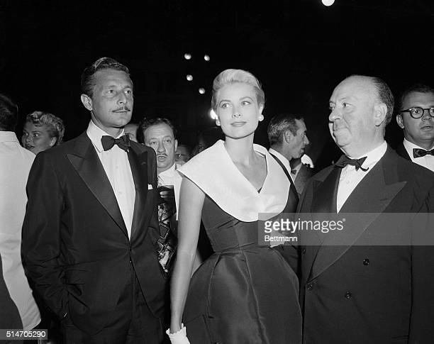 Alfred Hitchcock Grace Kelly and Oleg Cassini at the premiere of Rear Window