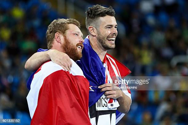 L to R Alister McQueen of Canada and Rory McSweeney of New Zealand congratulate each other after coming second and third respectively in Men's...