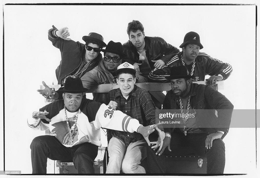 Mike D, DMC, MCA, Jam Master Jay; Front Row: DJ Hurricane, Ad-Rock, Run.