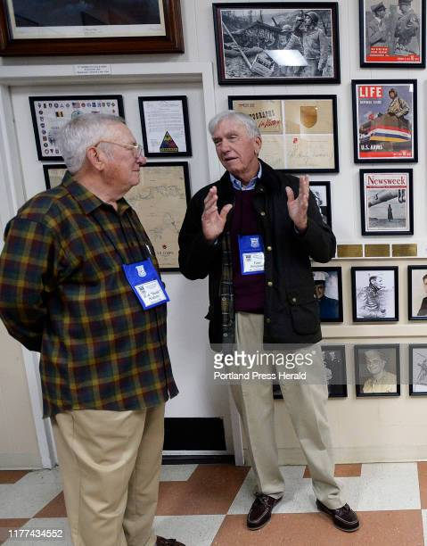 L to R Bob Hudson of Edgewood New Mexico and Tom Simpson of Mt Pleasant South Carolina talk during a ceremony for Vietnam POWs at the Maine Military...