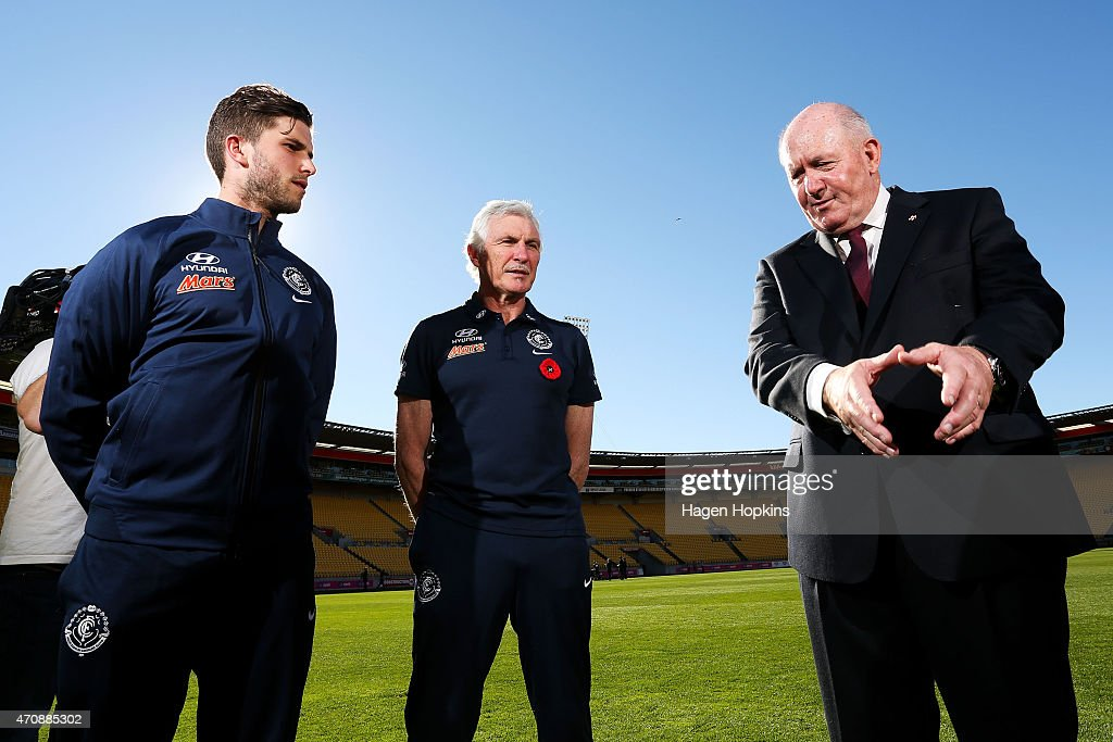 L to R, Captain Marc Murphy and coach Mick Malthouse of Carlton listen to Australian Governor-General Sir Peter Cosgrove after team training sessions at Westpac Stadium on April 24, 2015 in Wellington, New Zealand.