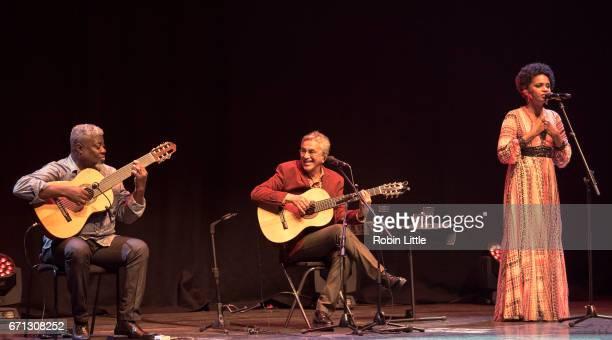 L to R Carlinhos Sete Cordas Caetano Veloso and Teresa Cristina perform at the Barbican on April 21 2017 in London England
