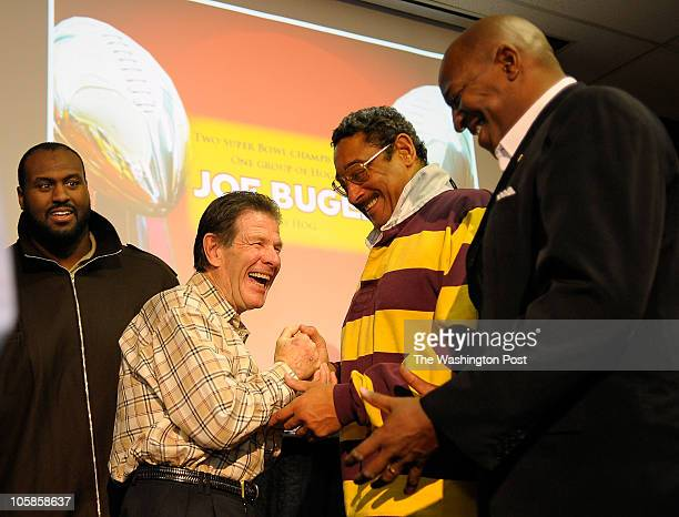 L to R Current offensive lineman Mike Williams retiring Redskins offensive line coach Joe Bugel shakes hand with his orginal linemen from the...