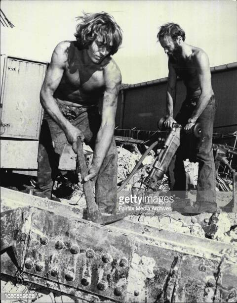 L to R Daniel Baxter and John Nicholson working at cleaning the waste concrete off large girders to make them ready for exportTwo young Sydney men...