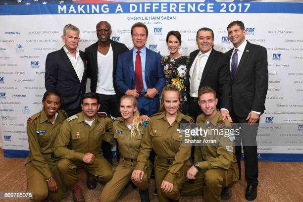 L to R David Foster Seal Arnold Schwarzenegger Cheryl and Haim Saban and Consul General of Israel in Los Angeles Sam Grundwerg with IDF soldiers at...