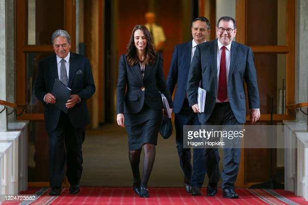 To R: Deputy Prime Minister Winston Peters, Prime Minister Jacinda Ardern, Greens leader James Shaw and Finance Minister Grant Robertson walk to the...