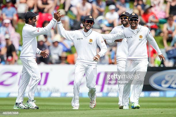 L to R Dilruwan Perera Dinesh Chandimal Lahiru Thirimanne and Dimuth Karunaratne of Sri Lanka celebrate the wicket of BJ Watling of New Zealand...
