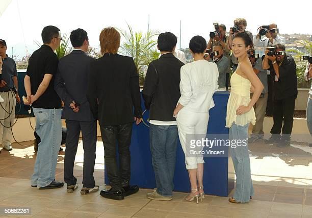 L to R Director Wong KarWai and actors Chang Chen Takuya Kimura Tony Leung Carina Lau and Zhang Ziyi attend '2046' photocall at Le Palais de Festival...