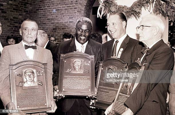 L to R Edd J Roush of the Cincinnati Reds Jackie Robinson of the Brooklyn Dodgers Bob Feller of the Cleveland Indians and Bill McKechnie who managed...