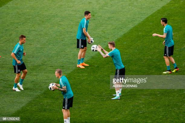 L to R Germany's defender Joshua Kimmich Germany's midfielder Toni Kroos Germany's forward Julian Draxler Germany's forward Marco Reus and Germany's...