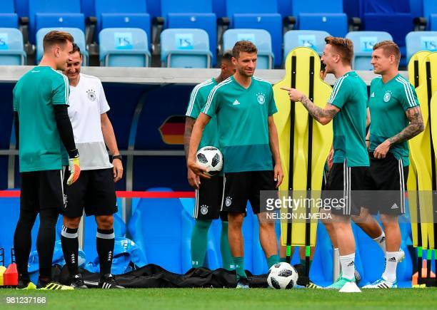 L to R Germany's goalkeeper MarcAndre Ter Stegen coaching assistant Miroslav Klose Germany's forward Thomas Mueller Germany's forward Marco Reus and...
