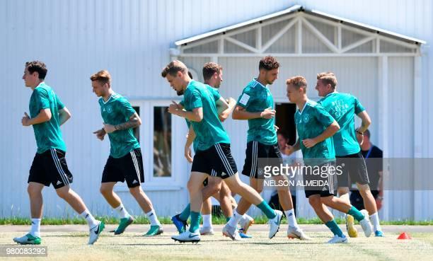 L to R Germany's midfielder Sebastian Rudy Germany's forward Marco Reus Germany's defender Matthias Ginter Germany's forward Thomas Mueller Germany's...