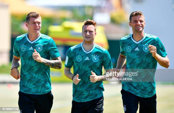 L to R Germany's midfielder Toni Kroos Germany's forward Marco Reus and Germany's forward Thomas Mueller take part in a training session at the...