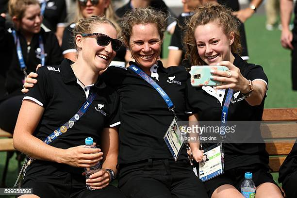 L to R Hannah van Kampen Kate Horan and Anna Grimaldi of New Zealand take a selfie during the New Zealand Paralympics Rio 2016 team welcome at...
