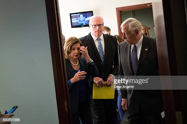 L to R House Minority Leader Nancy Pelosi Rep Joe Crowley and Rep Steny Hoyer exit a holding room as they leave a news conference discussing the...