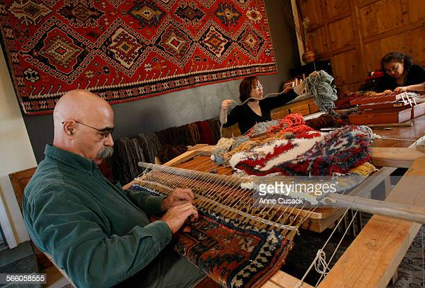 L to R Hratch Kozibeyokian Mira Kozibeyokian and Marie repair a rugs Hratch is renoun as a restorer of rugs from fine oriental rugs to authentic...