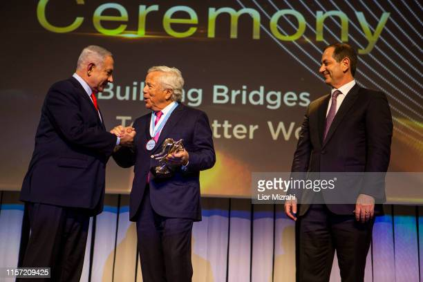 L to R Israel Prime Minister Robert Kraft and Stan Polovets on stage during the Genesis Prize ceremony at The Jerusalem Theater on June 20 2019 in...