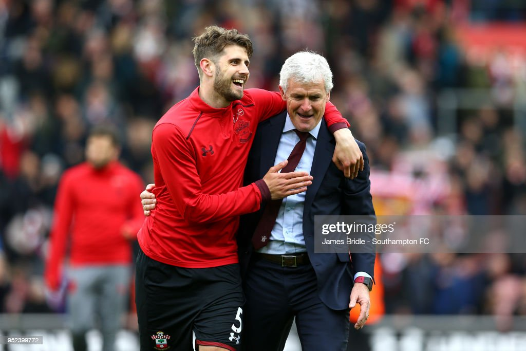 L to R Jack Stephens and Mark Hughes of Southampton celebrate after the final whistle is blown during the Premier League match between Southampton and AFC Bournemouth at St Mary's Stadium on April 28, 2018 in Southampton, England.