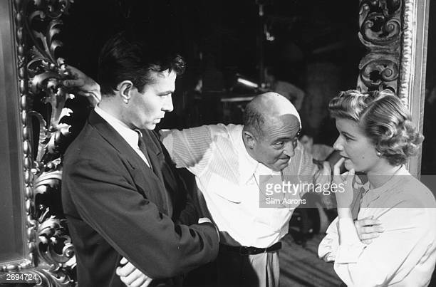 L to r James Mason director Max Ophuls and Barbara Bel Geddes on the set of the film 'Caught'