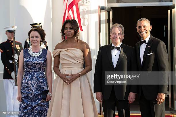 L to R Jenni Haukio First Lady Michelle Obama President of Finland Sauli Niinisto and US President Barack Obama pose for a group photo during...
