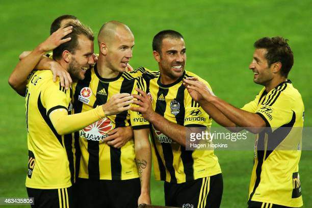 L to R Jeremy Brockie of the Phoenix celebrates his goal with teammates Stein Huysegems Manny Muscat and Vince Lia during the round 15 ALeague match...