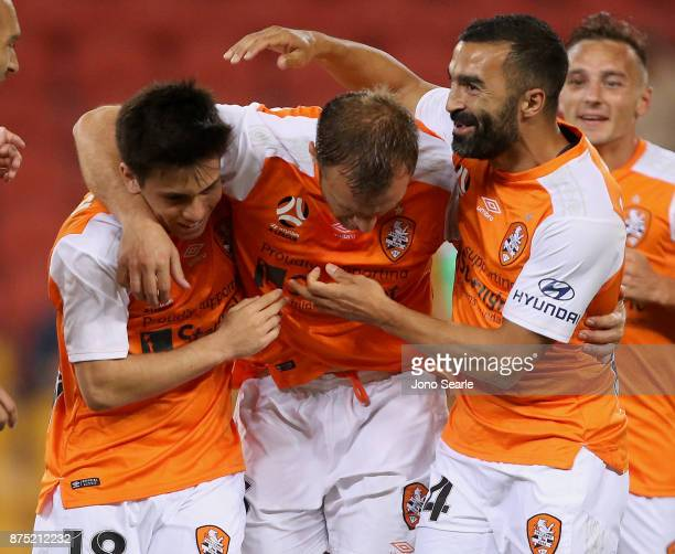 L to R Joe Caletti Avram Papadopoulos and Fahid Ben Khalfallah of the Brisbane Roar celebrate a Papadopoulos goal during the round seven ALeague...