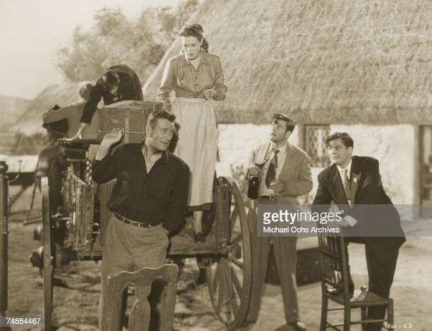L to R John Wayne Maureen O'Hara Sean McClory and Charles Fitzsimons on the set of The Quiet Man directed by John Ford circa 1952 in Los Angeles...