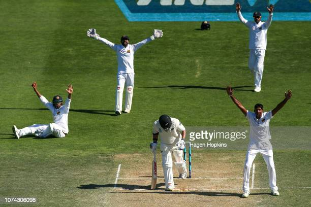 L to R Kusal Mendis Niroshan Dickwella Dhananjaya De Silva and Kasun Rajitha of Sri Lanka appeal unsuccessfully for the wicket of Ajaz Patel of New...