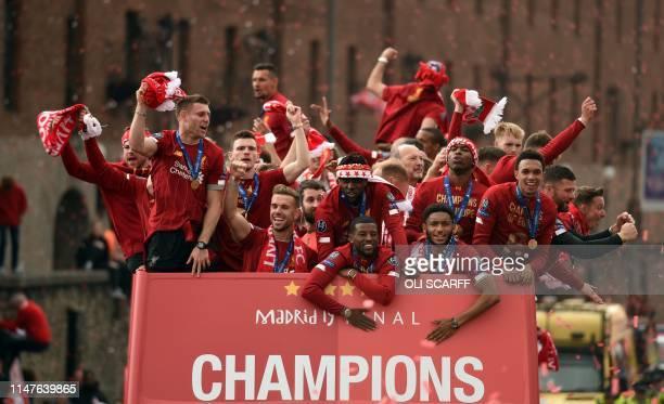 L to R Liverpool's Spanish defender Alberto Moreno Liverpool's English midfielder James Milner Liverpool's Scottish defender Andrew Robertson...