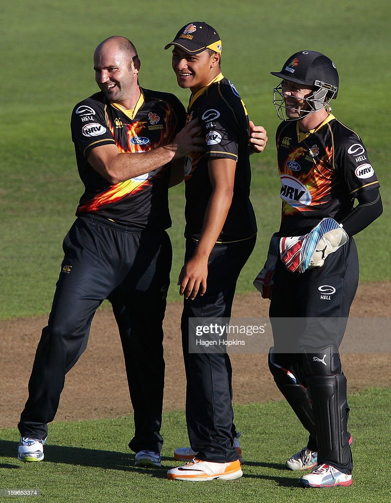 L to R, Luke Woodcock, Malaesaili Tugaga and Luke Ronchi of Wellington celebrate the wicket of Donovan Grobbelaar of Auckland during the HRV Cup Twenty20 Preliminary Final between the Wellington Firebirds and the Auckland Aces at Basin Reserve on January 18, 2013 in Wellington, New Zealand.