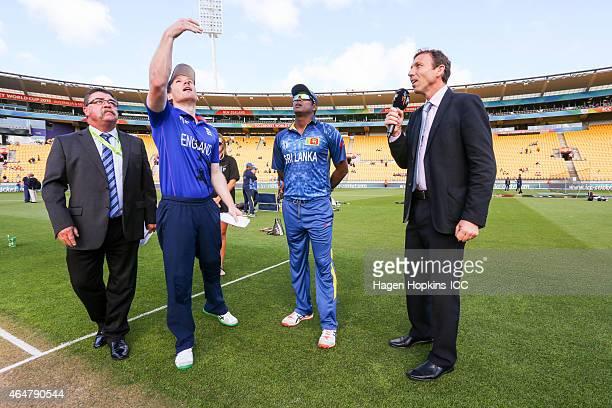L to R Match referee Rob Marsh Eoin Morgan of England Angelo Mathews of Sri Lanka and cricket commentator Michael Atherton take part in the coin toss...