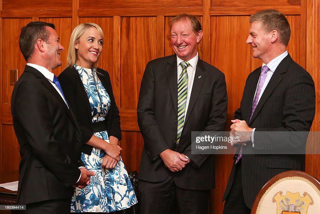 L to R, Michael Woodhouse, Nikki Kaye and Nick Smith share a laugh with Deputy Prime Minister Bill English during a swearing-in ceremony at Government House on January 31, 2013 in Wellington, New Zealand. After a recent Cabinet reshuffle by Prime Minister John Key, Dr Nick Smith was appointed Minister of Housing, Nikki Kaye was appointed Minister for Food Safety, Youth Affairs and Civil Defence while Michael Woodhouse was appointed as a Minister, outside of Cabinet, for Immigration and Veterans Affairs.