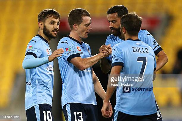 L to R Milos Ninkovic Brandon O'Neill Alex Brosque and Michael Zullo of Sydney FC celebrate the win after the final whistle during the round three...