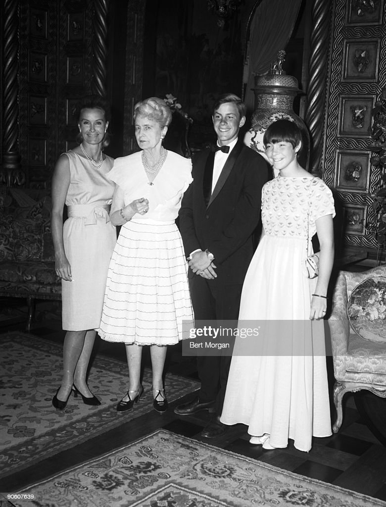 Mrs Stanley Rumbough (Dina Merrill), her mother Mrs Maerriweather Post, and her children David Rumbough and Nedenia Rumbough, at Mrs Merriweather Post's Dance Party at estate 'Mar-A-Lago' in Palm Beach, Florida