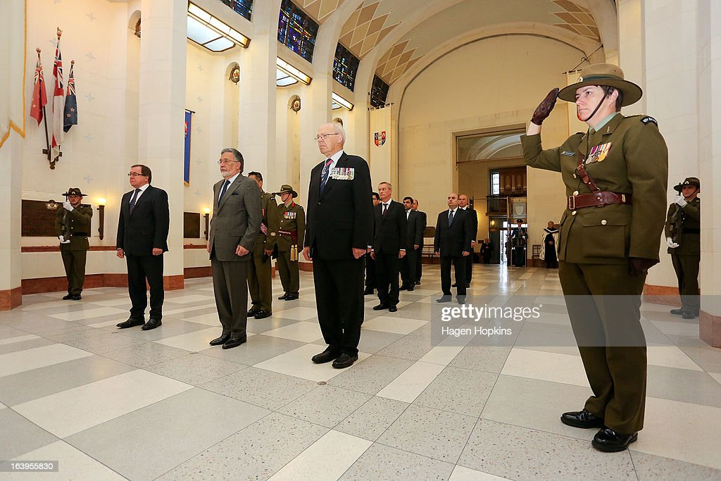 L to R, New Zealand Foreign Affairs Minister Murray McCully, Afghan Foreign Minister Dr Zalmai Rassoul and retired Air Vice-Marshal RNZAF Robin Klitscher look on while a soldier salutes during a wreath-laying ceremony to acknowledge both Afghan and New Zealand losses in Afghanistan at the National War Memorial on March 19, 2013 in Wellington, New Zealand. Afghan Foreign Minister Dr Zalmai Rassoul is on the second day of a two day visit to New Zealand for bilateral talks.