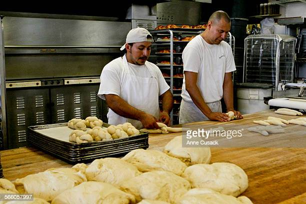 L to r Oscar Flores and Walter Cocka braid the challah dough at Abby Franke's bakery Stone Ground in Aguoura Hills on August 16 2010