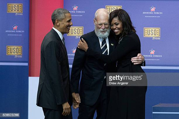 L to R President Barack Obama looks on as David Letterman hugs First Lady Michelle Obama during a comedy show organized by United Services...