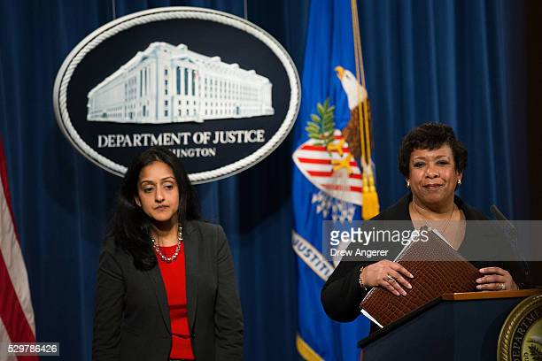 L to R Principal Deputy Assistant Attorney General Vanita Gupta head of the Justice Department's Civil Rights Division looks on as US Attorney...