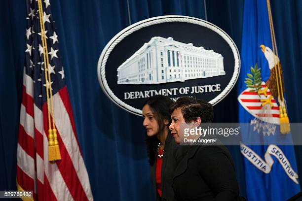 L to R Principal Deputy Assistant Attorney General Vanita Gupta head of the Justice Department's Civil Rights Division and US Attorney General...