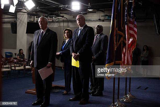 L to R Rep Steny Hoyer House Minority Leader Nancy Pelosi Rep Joe Crowley and Rep James Clyburn pause as they watch a video showing clips of House...