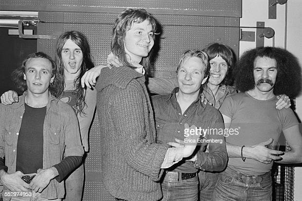 Rick Worsnop Paul Chapman Tony Smith Dixie Lee Kenny Driscoll Pete Hurley of Lone Star pose for a group portrait backstage in St Albans United...
