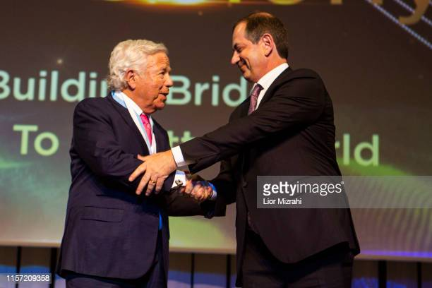 L to R Robert Kraft and Stan Polovets on stage during the Genesis Prize ceremony at The Jerusalem Theater on June 20 2019 in Jerusalem Israel
