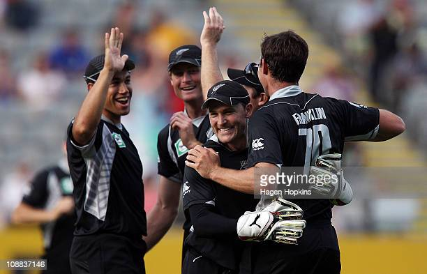 L to R Ross Taylor Martin Guptill Brendon McCullum and James Franklin of the Black Caps celebrate after taking a wicket during game six of the one...