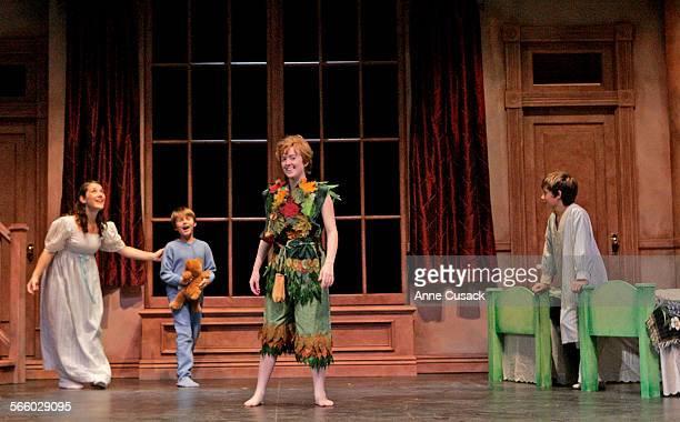 L to R Sarah Bierstock as Wendy Ryan Dalforno as Michael Corina Boettger as Peter Pan and Jordan Lemmond as John in the nursery scene as The Santa...