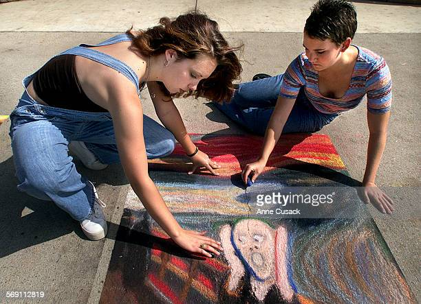 L to R Seniors Holly Hurd age 17 and Michaele Saddler age 18 put the finishing touches on their chalk paintings at Buena Hgih School in Ventura in...
