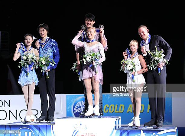 L to R Silver medalists Qing Pang Jian Tong of China gold medalists Tatiana Volosozhar Maxim Trankov of Russia and bronze medalists Caydee Denney...